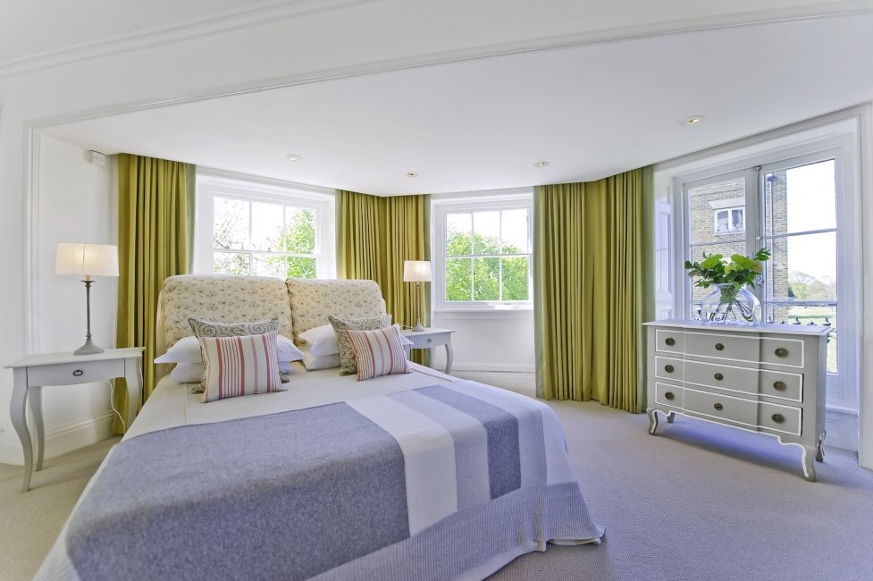 spacious bedroom with luxury carpet