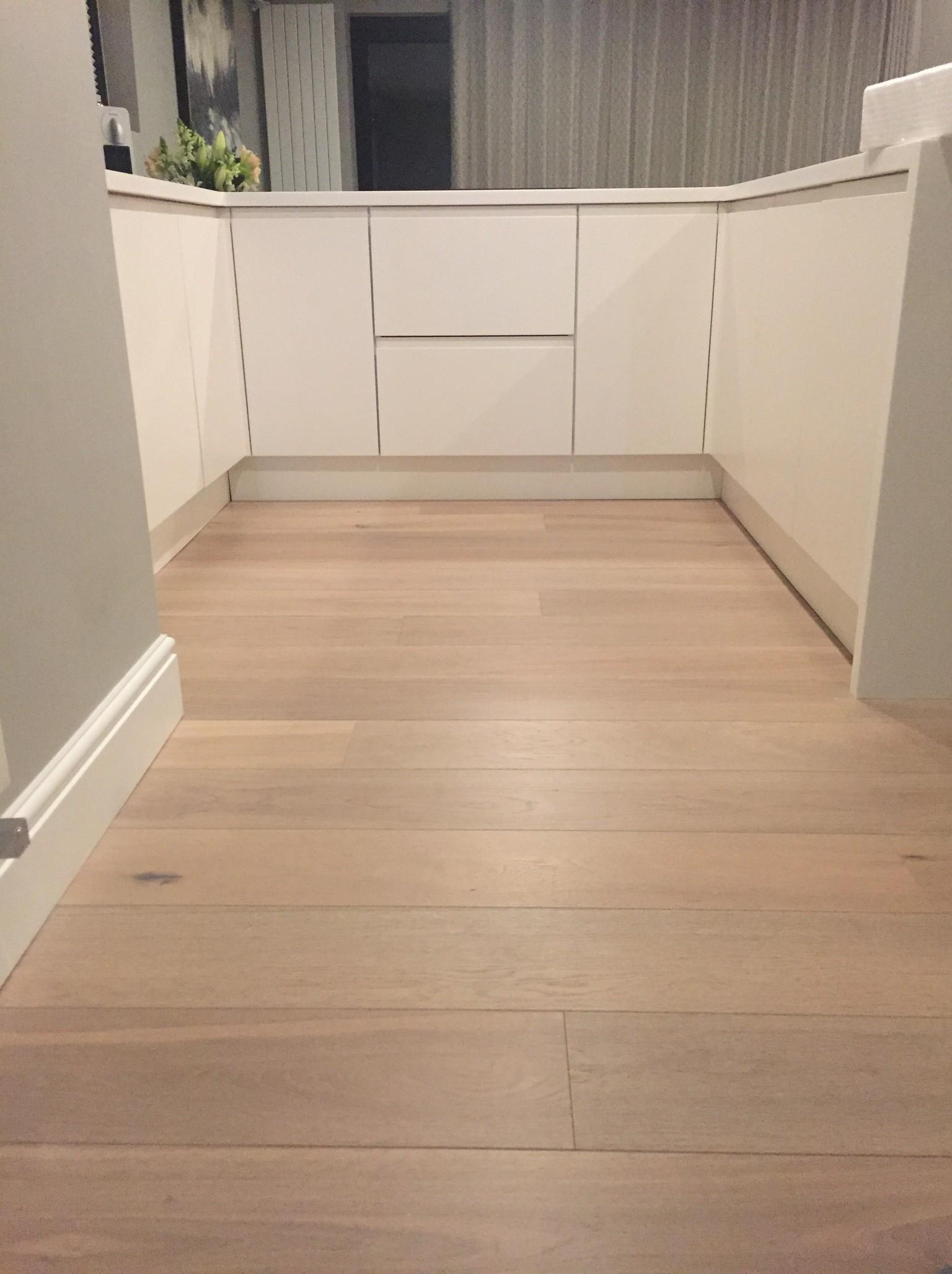 white washed engineered oak plank wood flooring in kitchen