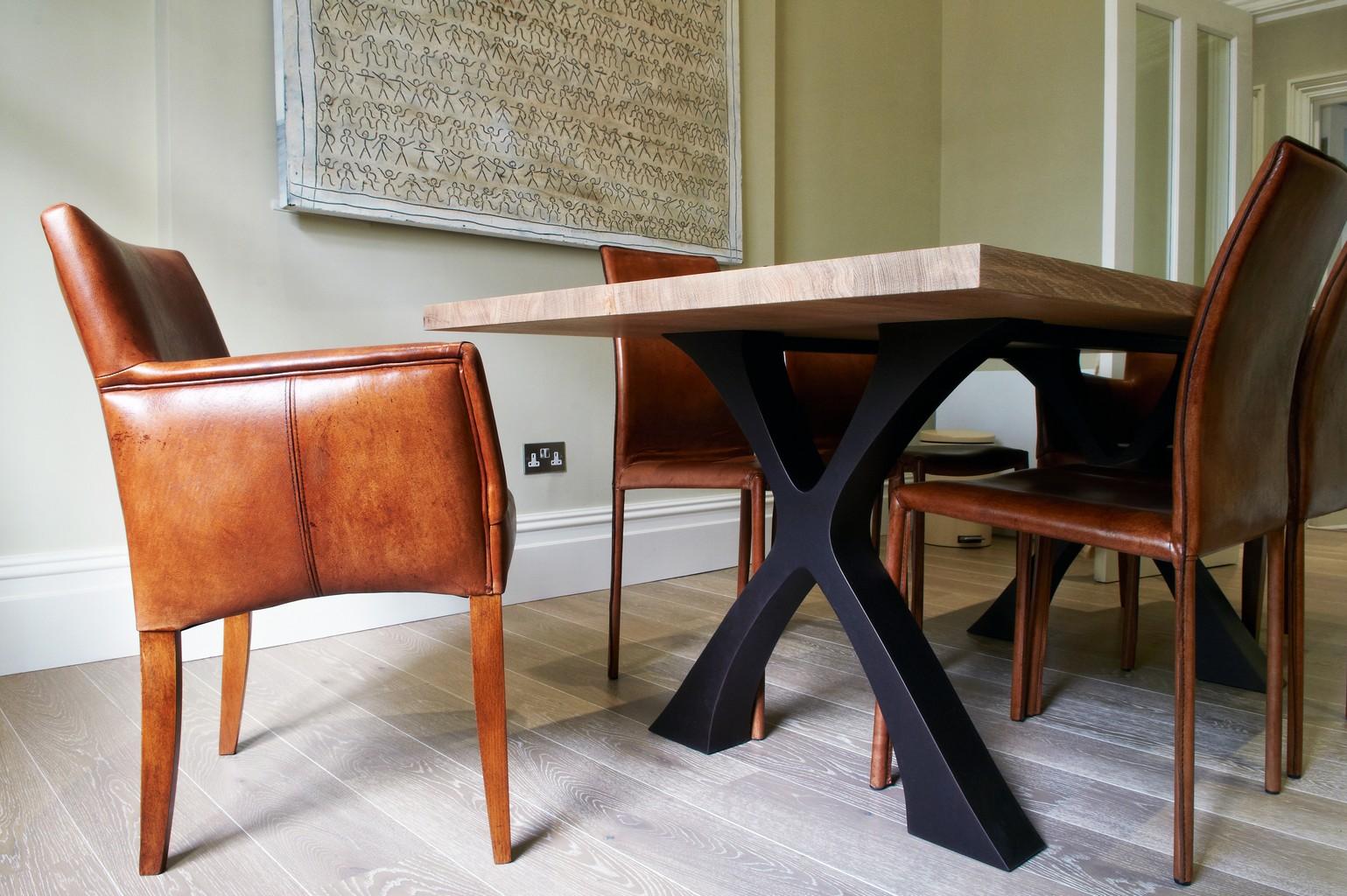 white washed oak plank wood flooring under modern table