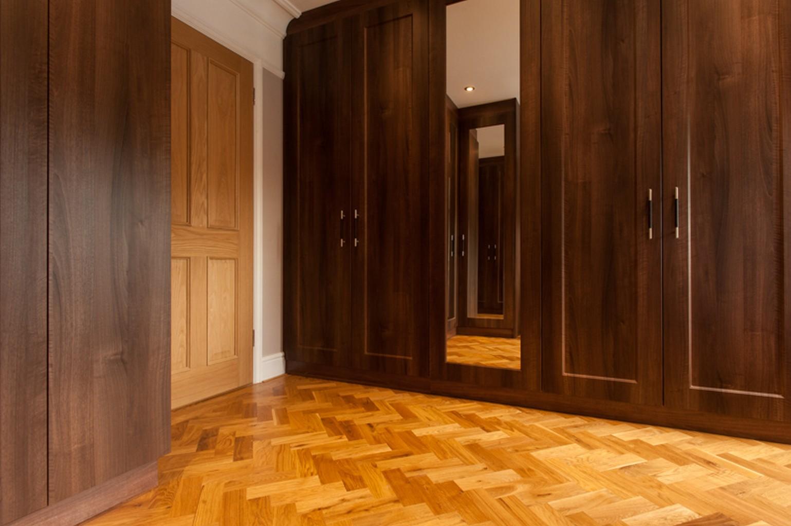 herringbone luxury wood flooring and wooden closets