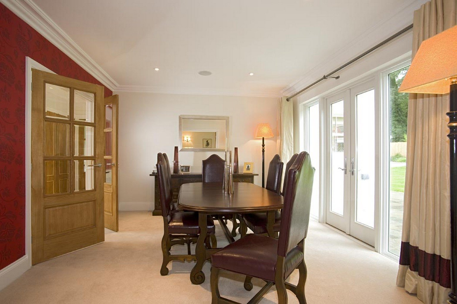 cream luxury carpet in dining room with french doors