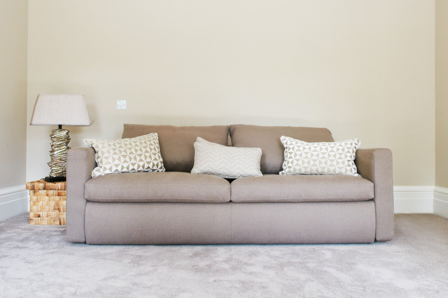 pale grey silk effect luxury carpet and sofa