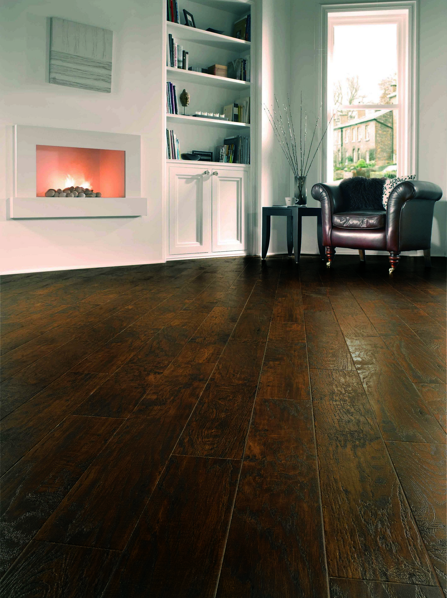 luxury vinyl karndean and amtico flooring with dark leather armchair