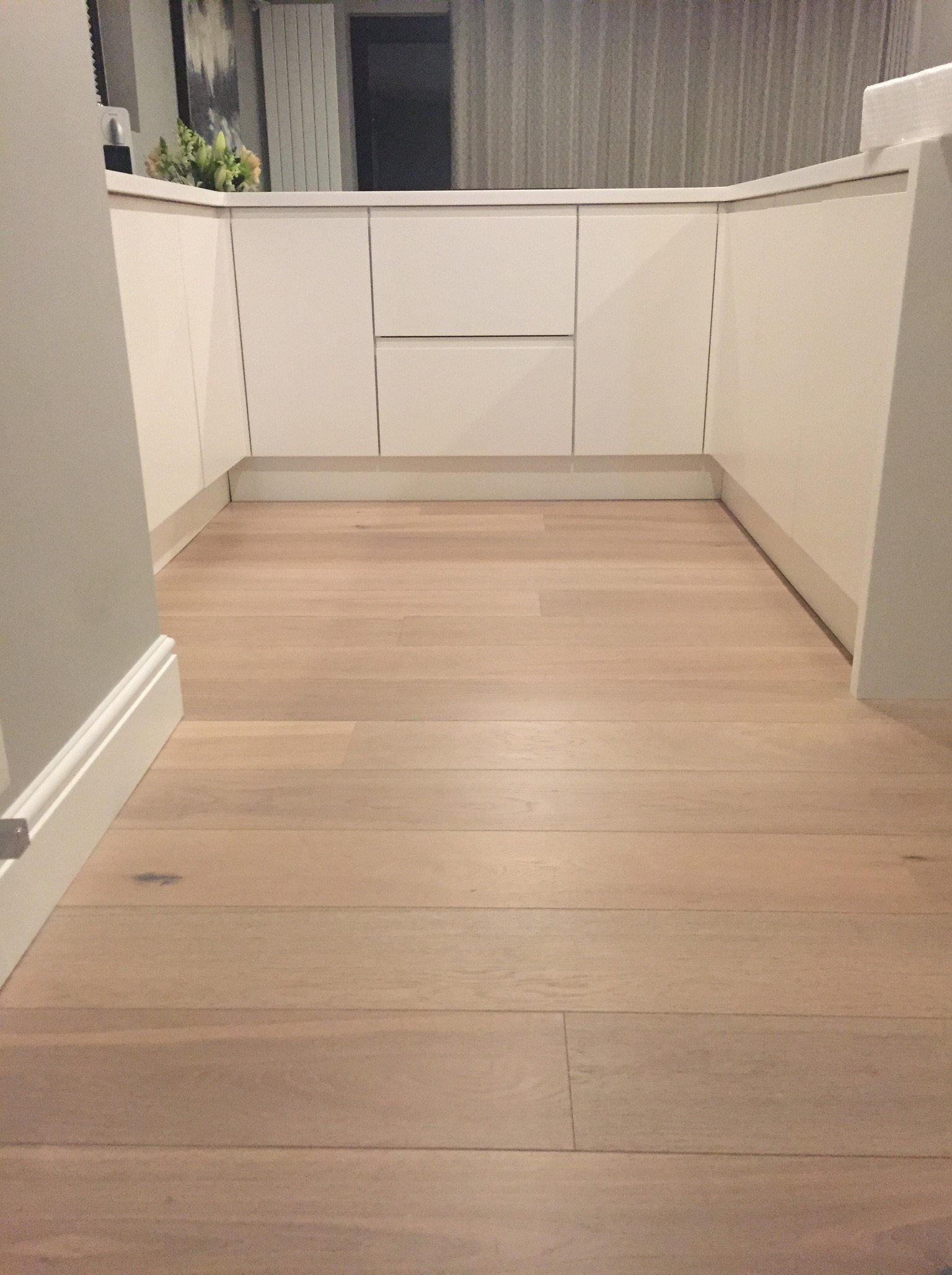 white washed engineered oak plank wood flooring in kitchen