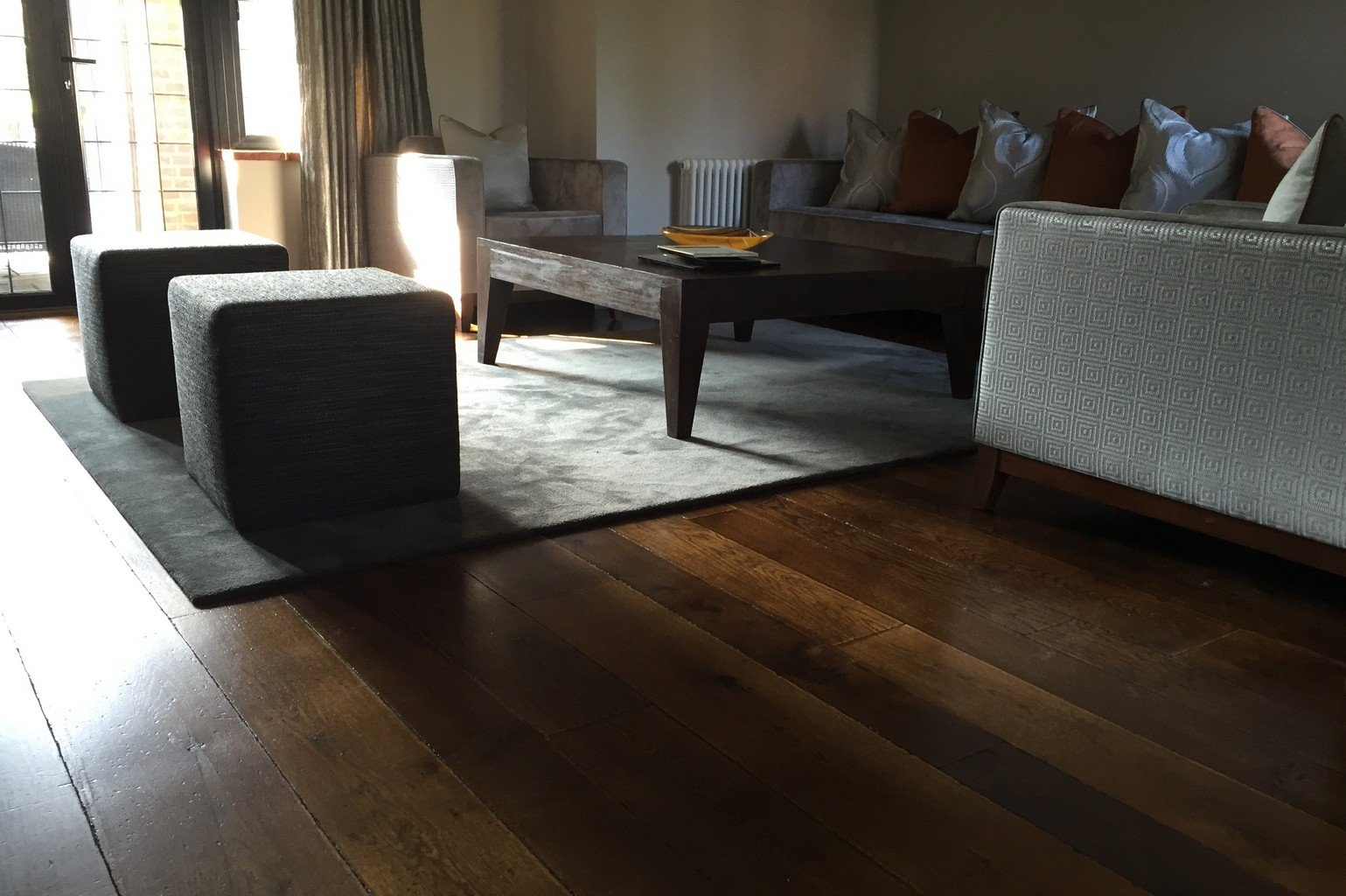 luxury wood flooring and luxury faux silk rug