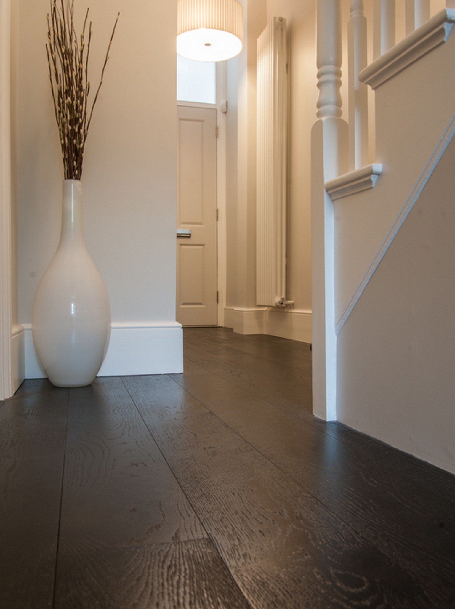 luxury wood flooring and white vase