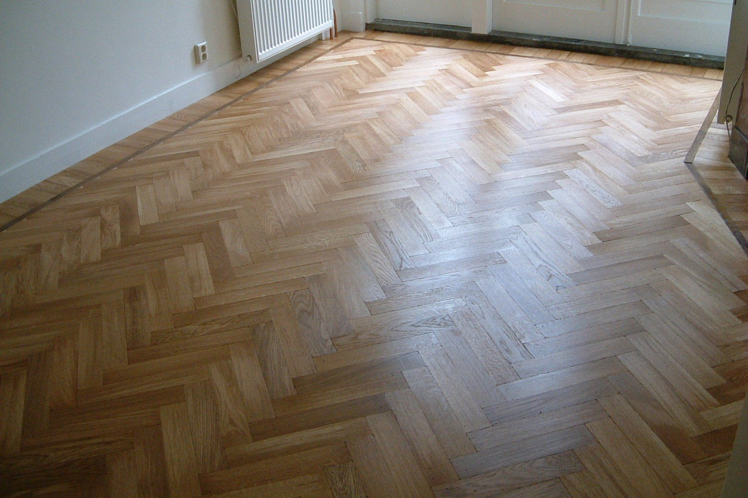 herringbone luxury wood flooring in cream room