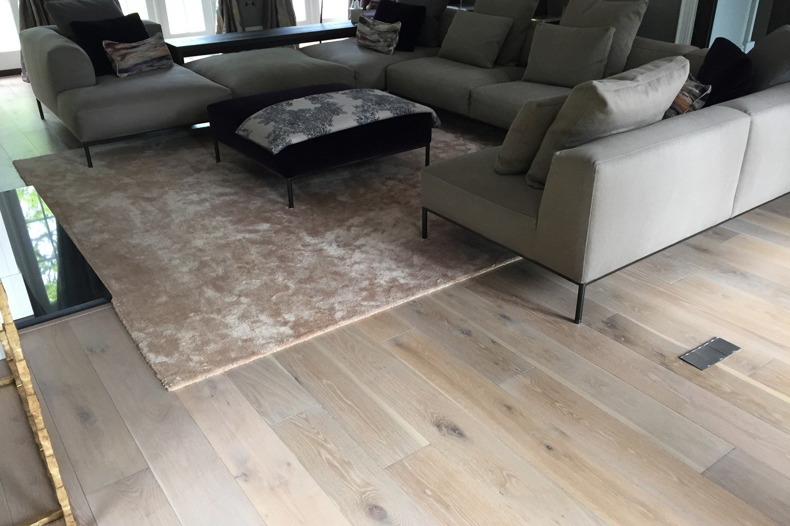 luxury wood flooring and pink faux silk rug