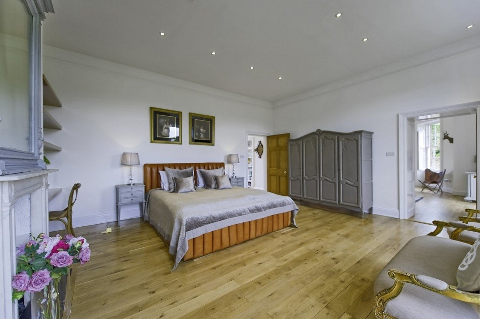luxury wood flooring in spacious bedroom