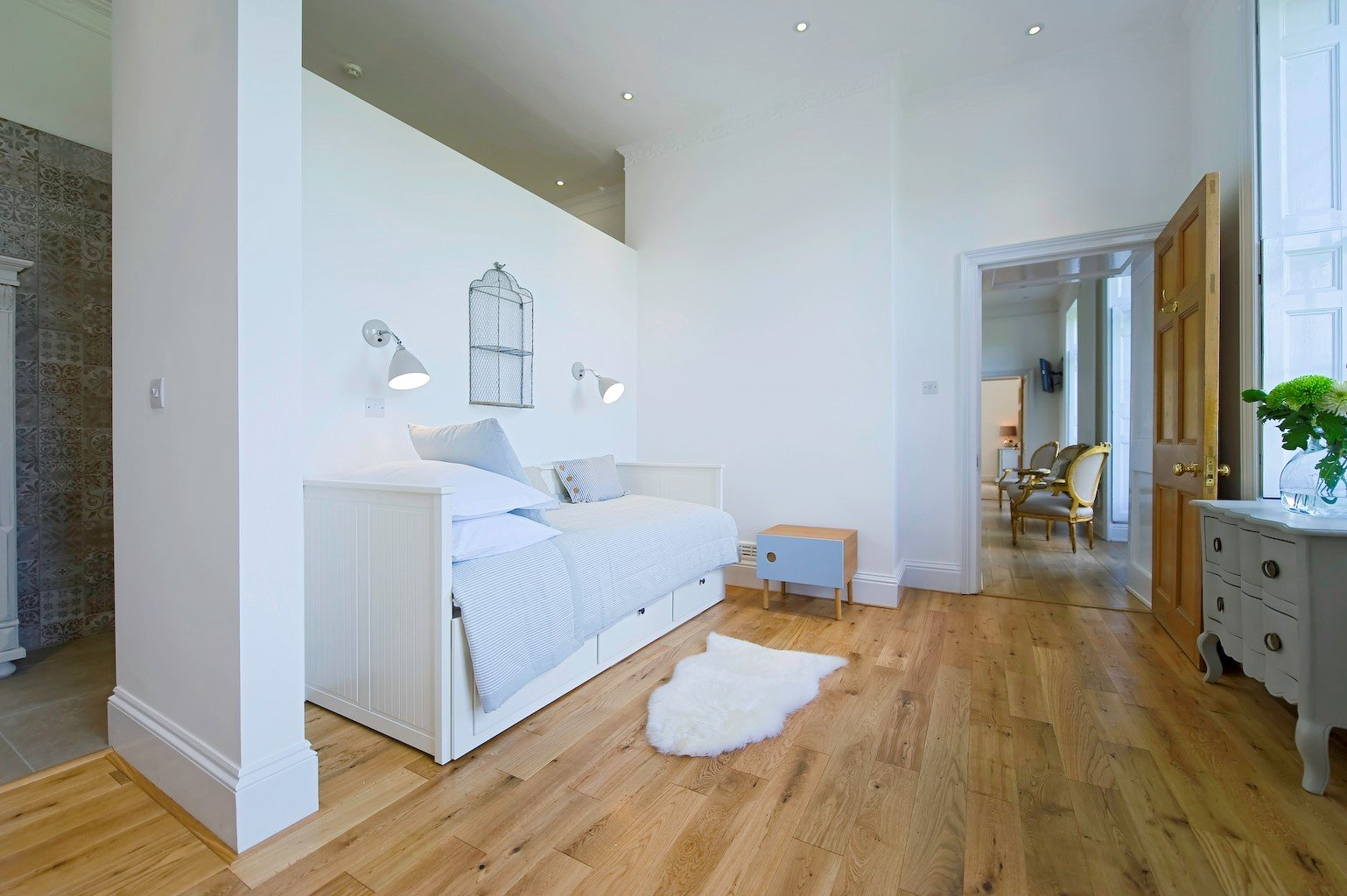 wood flooring and white day bed