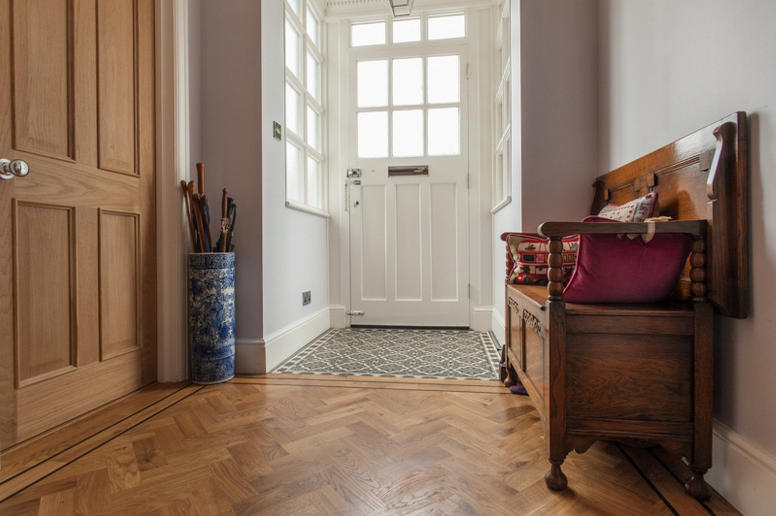 herringbone wood flooring in entranceway